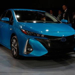 2017-Toyota-Prius-Prime-side-front-view-on-show-floor