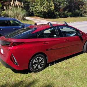 2017 Toyota Prius Prime (Hypersonic Red) rear angle